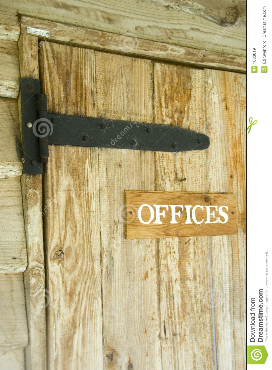 Wooden door with offices signage