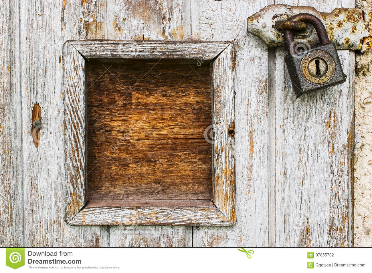 Wooden door with padlock and frame
