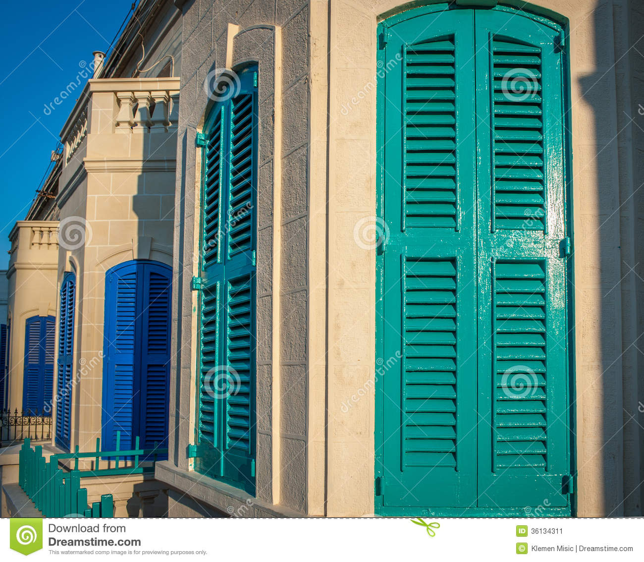 turquoise and blue wooden door shutters street