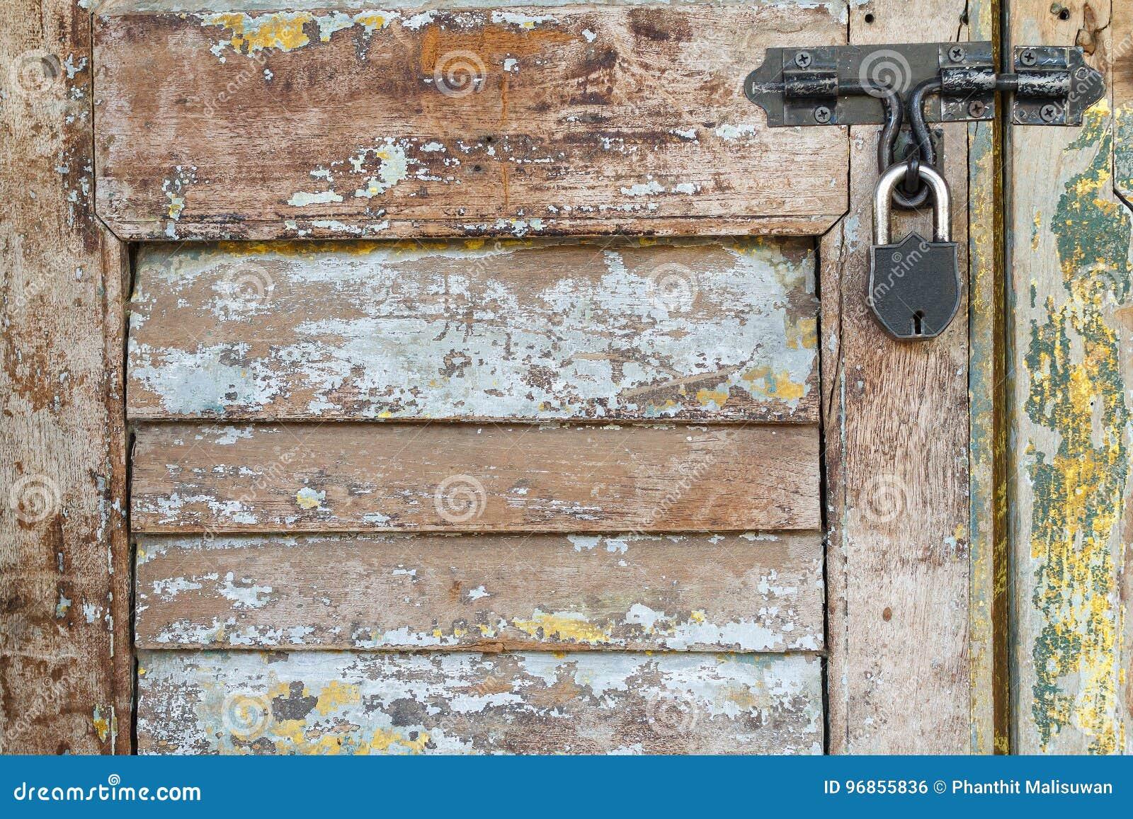 Locked Door With Key Stock Photo 56128692