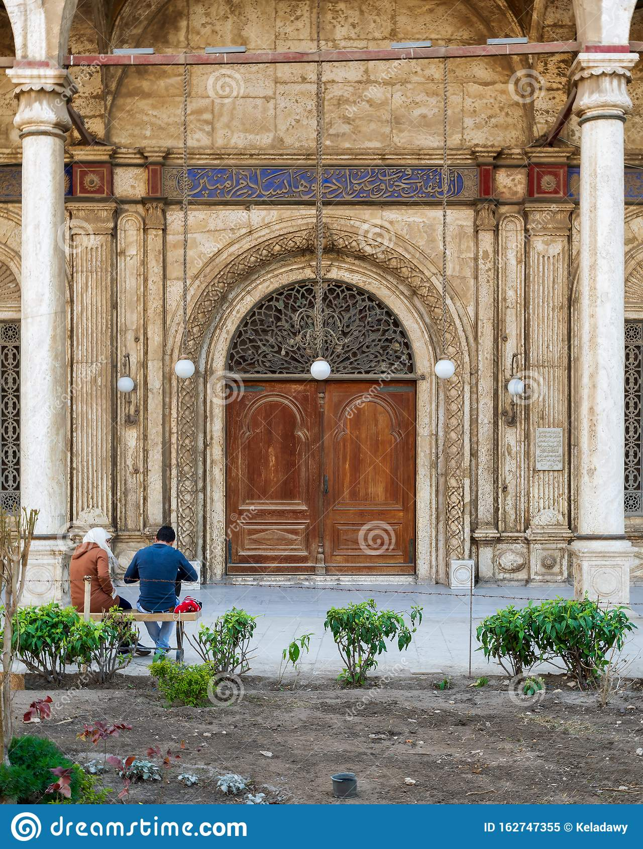 Wooden door and white marble decorated wall, side entrance of Muhammad Ali Mosque, Citadel of Cairo