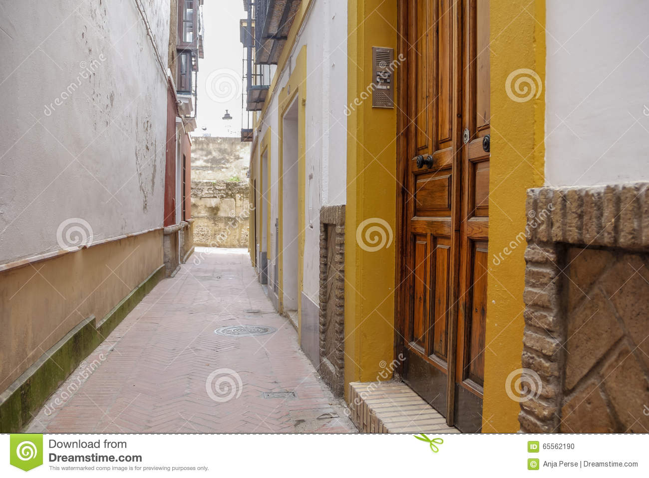 wooden doors in narrow street stock photo image of spanish brick