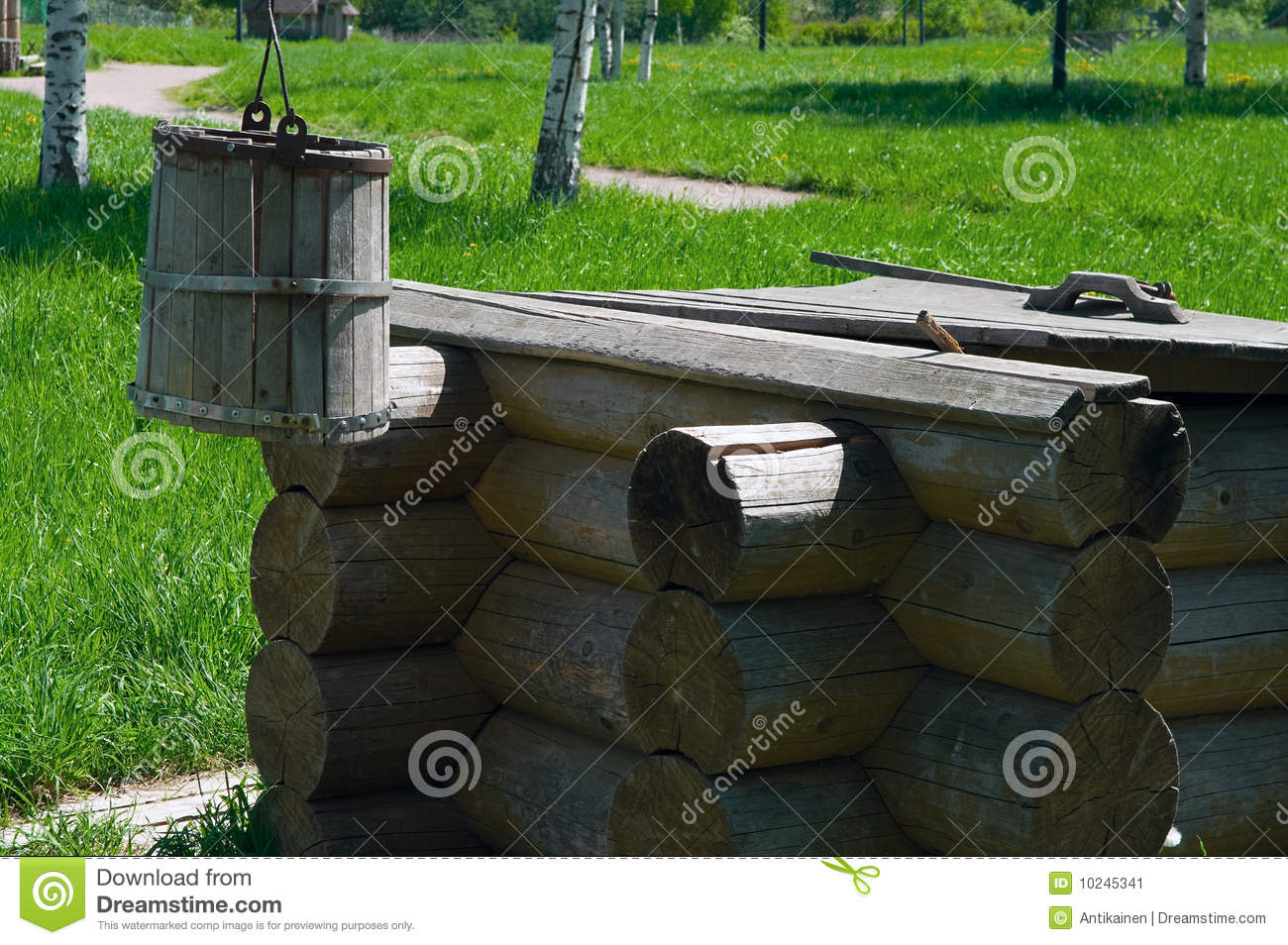 Wooden draw well with bucket