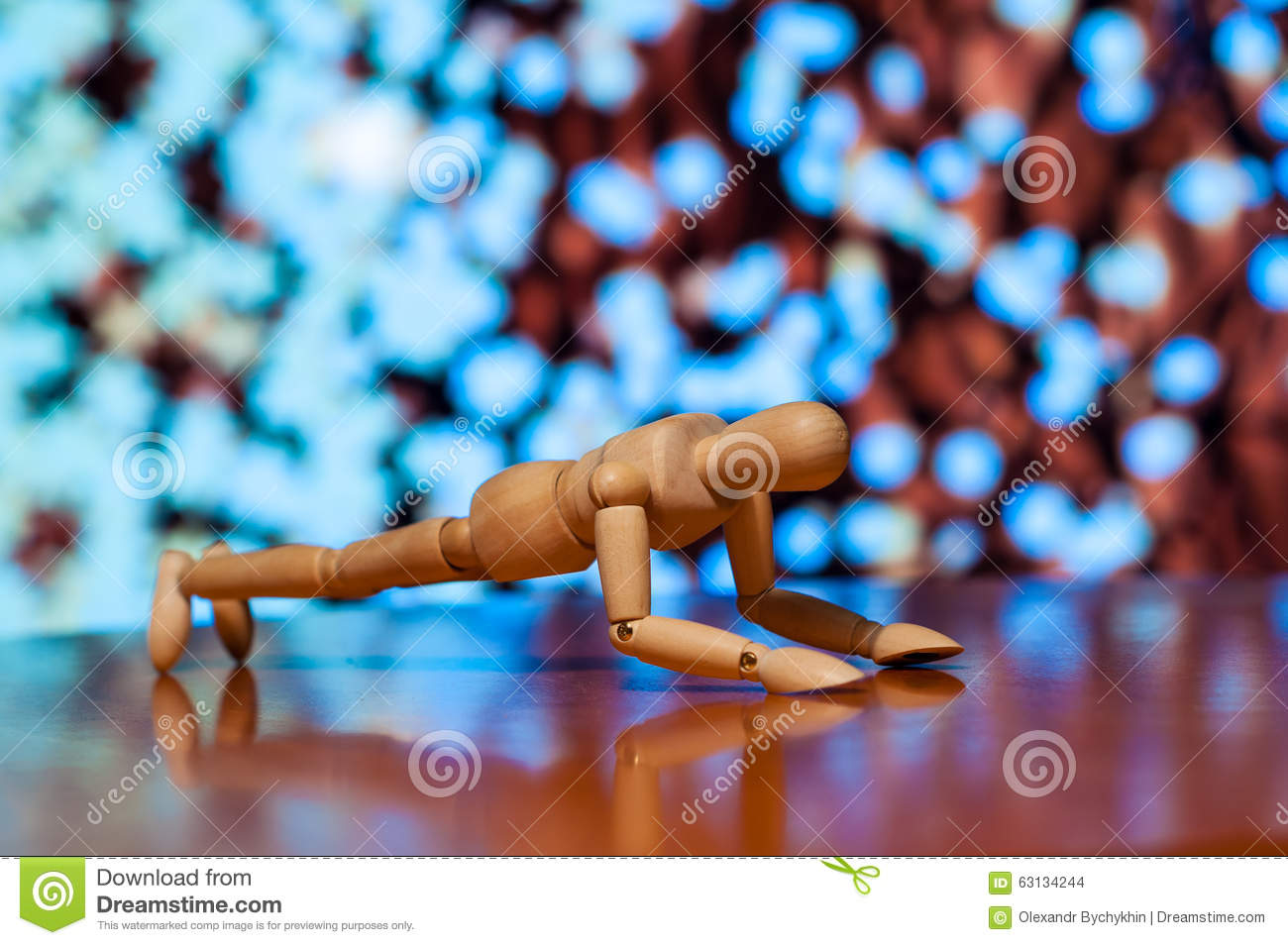 Wooden dummy, mannequin or man figurine exercising