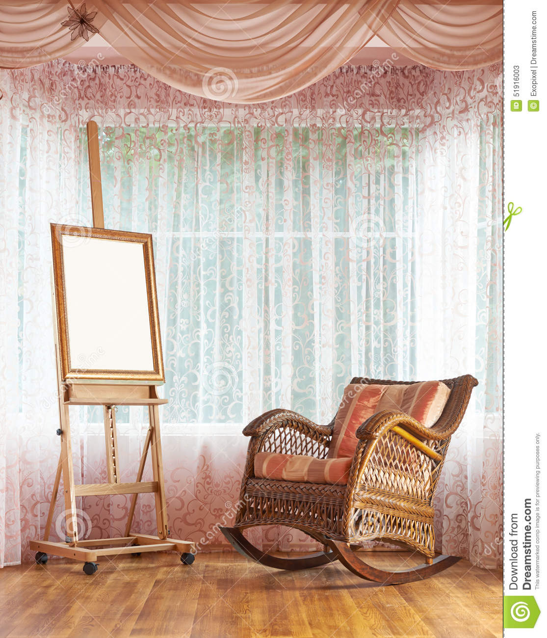 Wooden easel and wicker rocking chair composition stock for Chair next to window