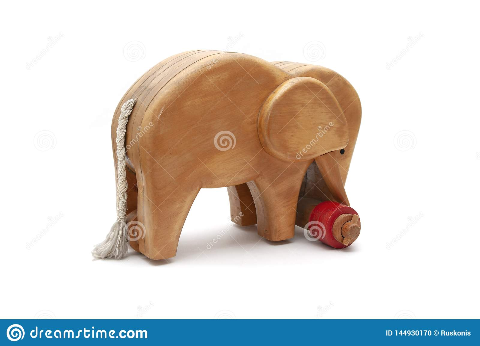 Wooden elephant with red wheels and tail