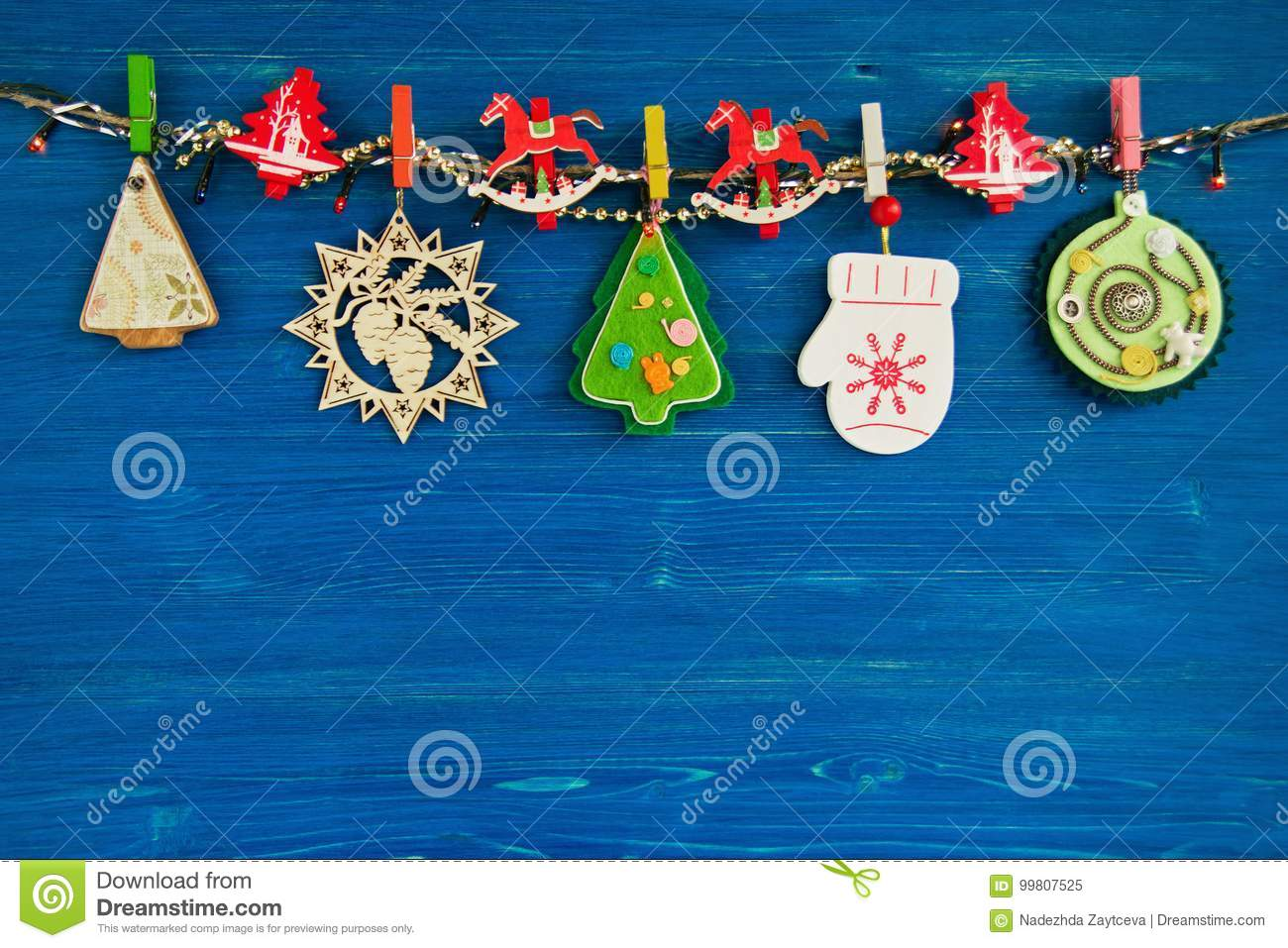 Wooden and felt christmas decorations and christmas lights on a rope download wooden and felt christmas decorations and christmas lights on a rope on the blue wooden aloadofball Gallery