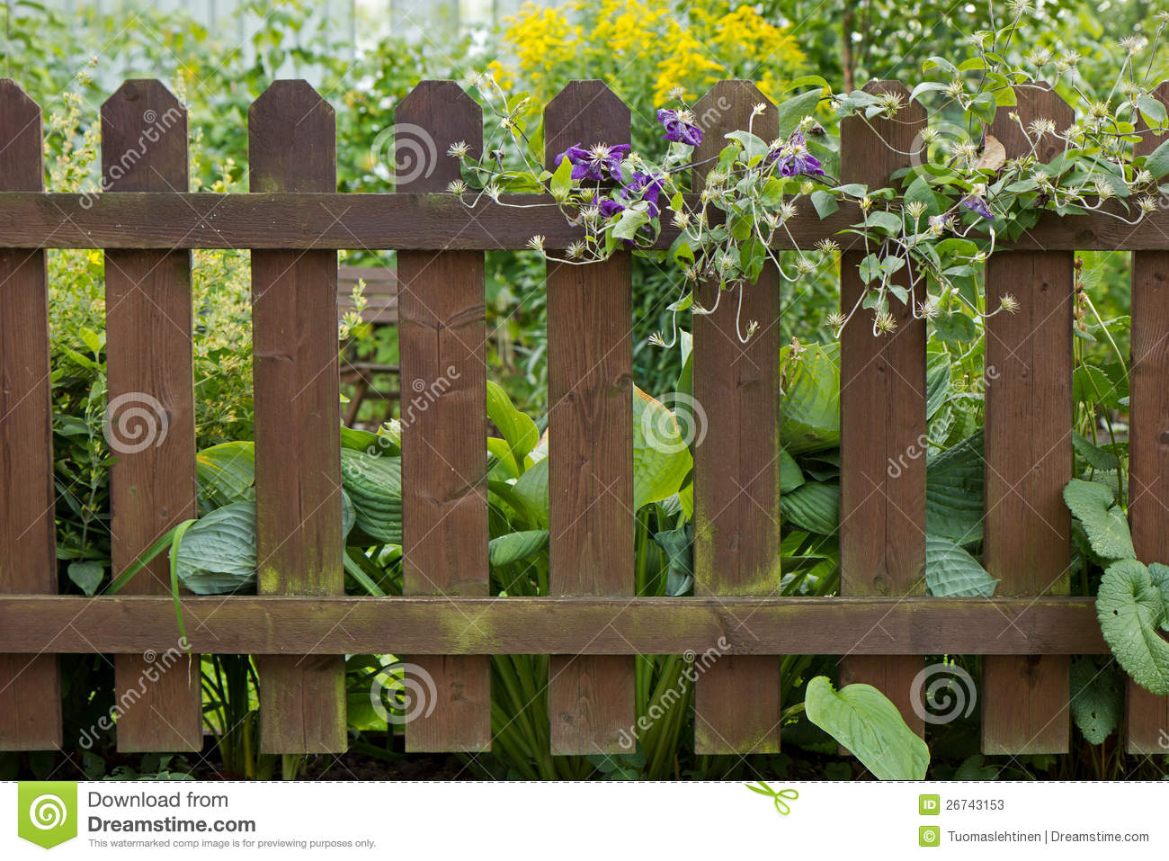 Wooden Fence At A Garden