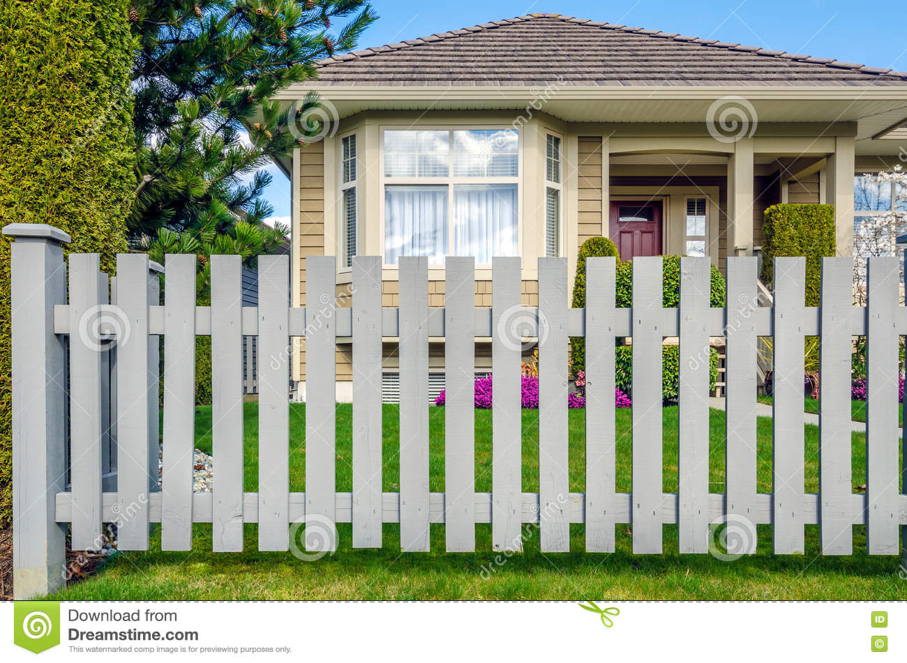 Wooden fence and house in background stock photo image for House behind house designs