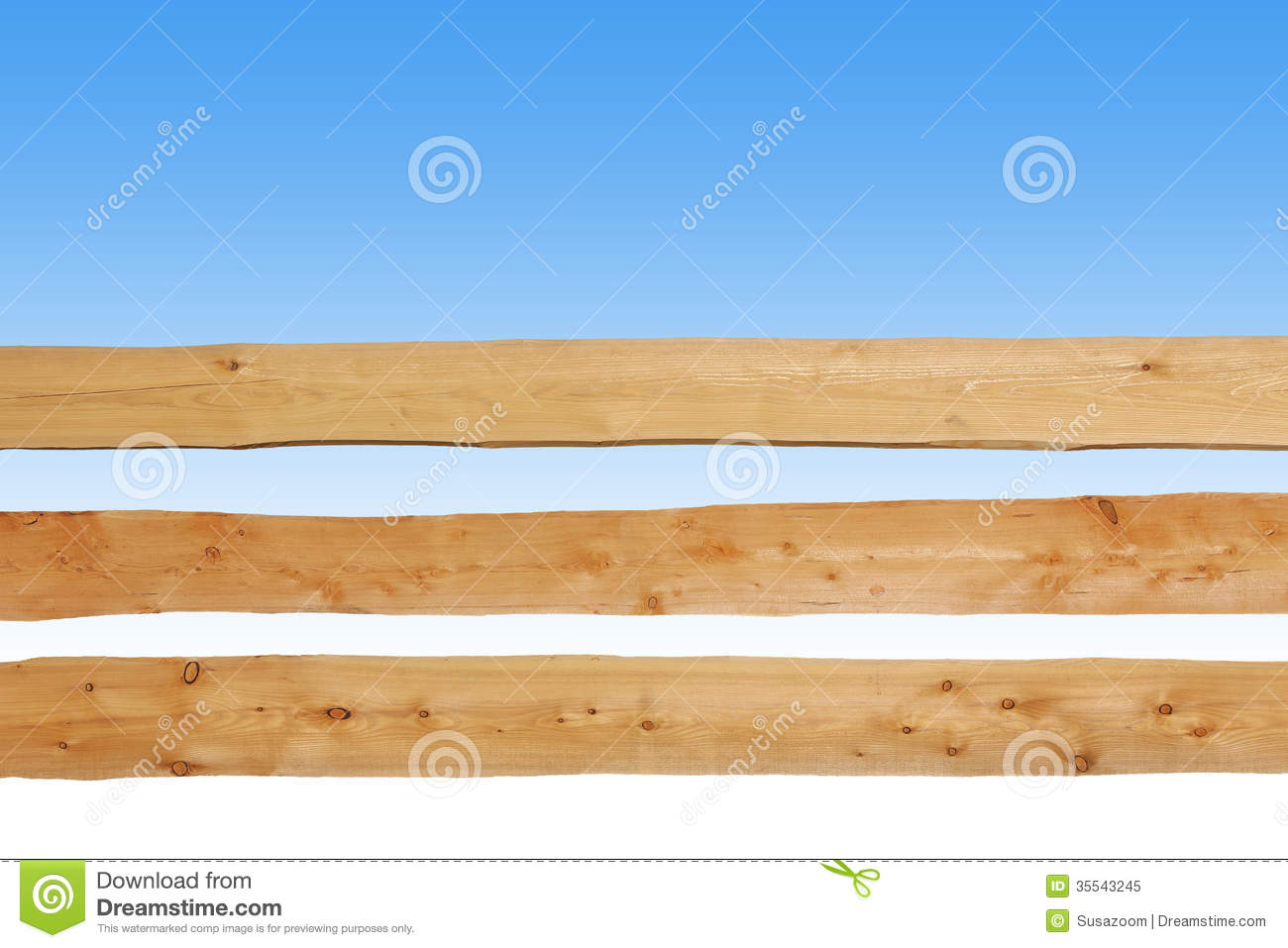 Wooden fence made of horizontal planks against blue sky
