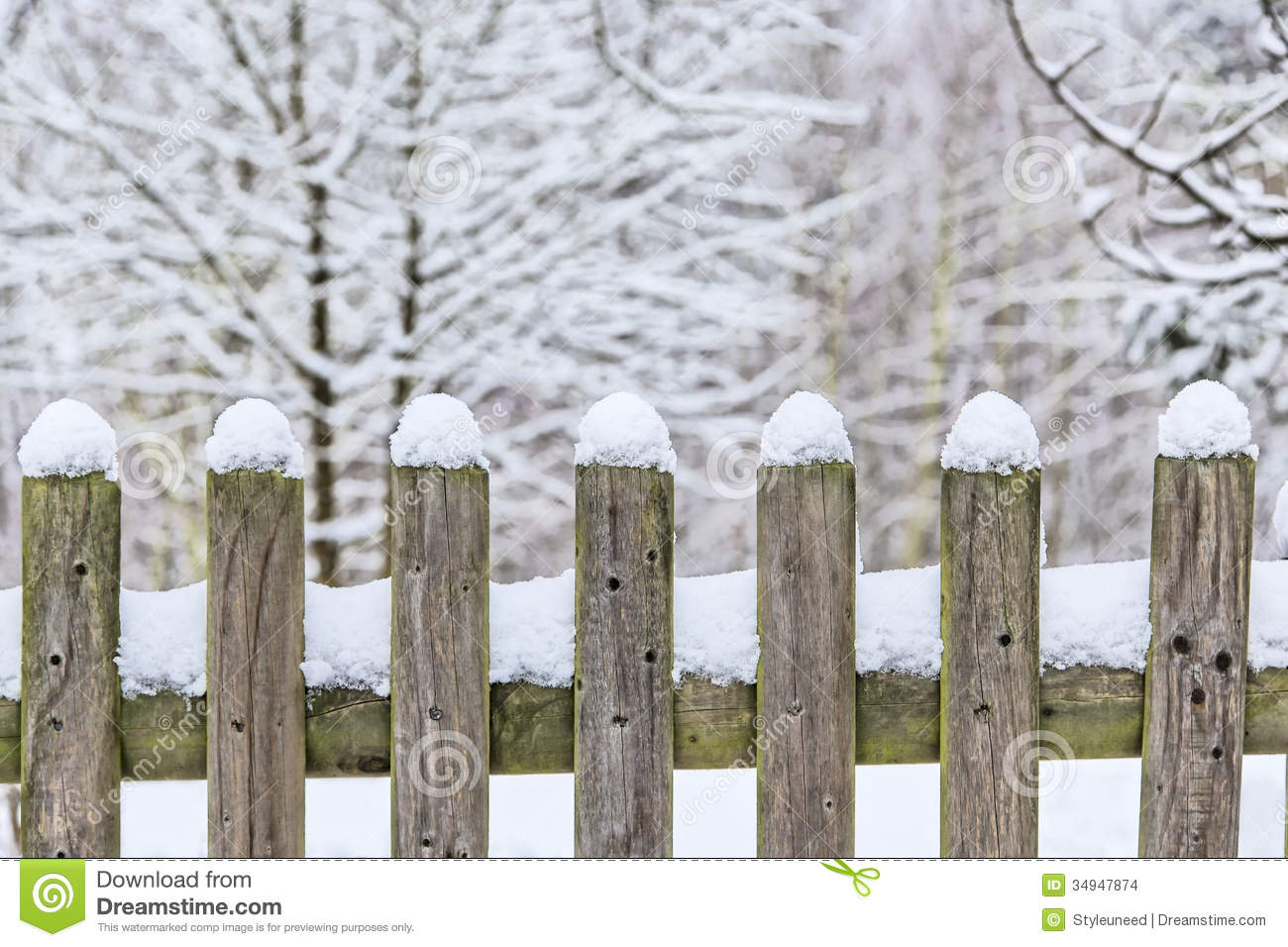 Wooden fence in snow with trees stock photo image of
