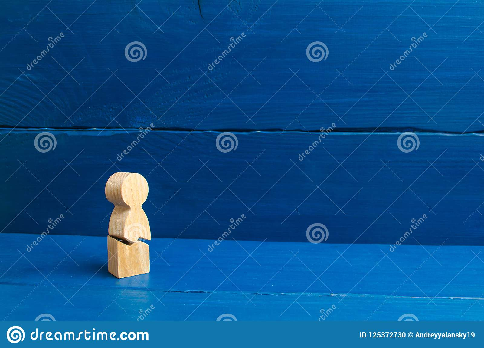 A wooden figure of a man with a crack. The concept of psychological stress and pressure. Could not stand our nerves and our health
