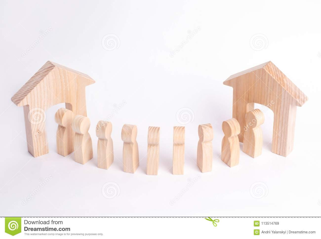 A wooden figure of a man meets a guest on a white background. Wooden house. The concept of an apartment house, real estate. Buying