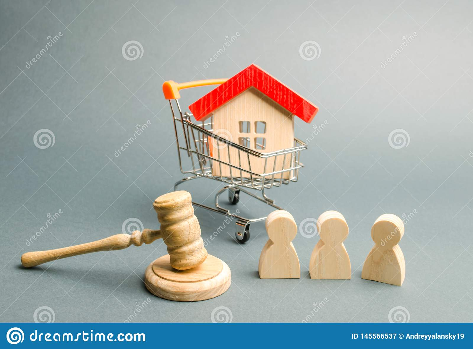 The House Of Hammer wooden figures of people, a house in a supermarket trolley