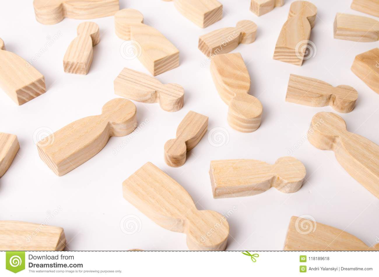 Wooden figures of people are lying on a white background. The concept of human resources management. Headhunters.