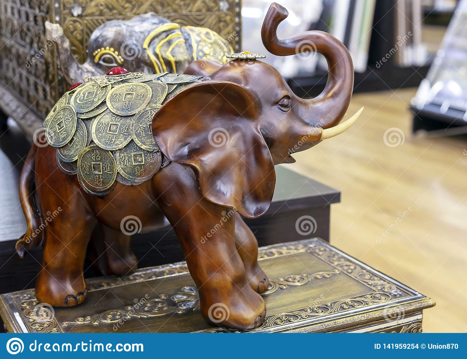 Wooden figurine of an elephant decorated with coins