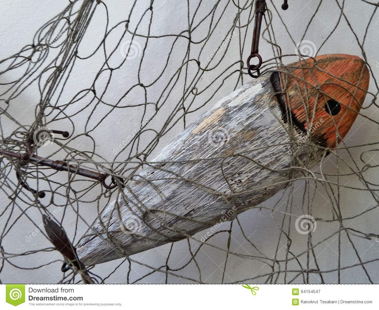 Wooden fish in fishing net stock photo image 64154547 for Wooden fishing net