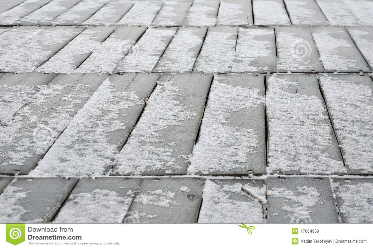Wooden floor covered snow