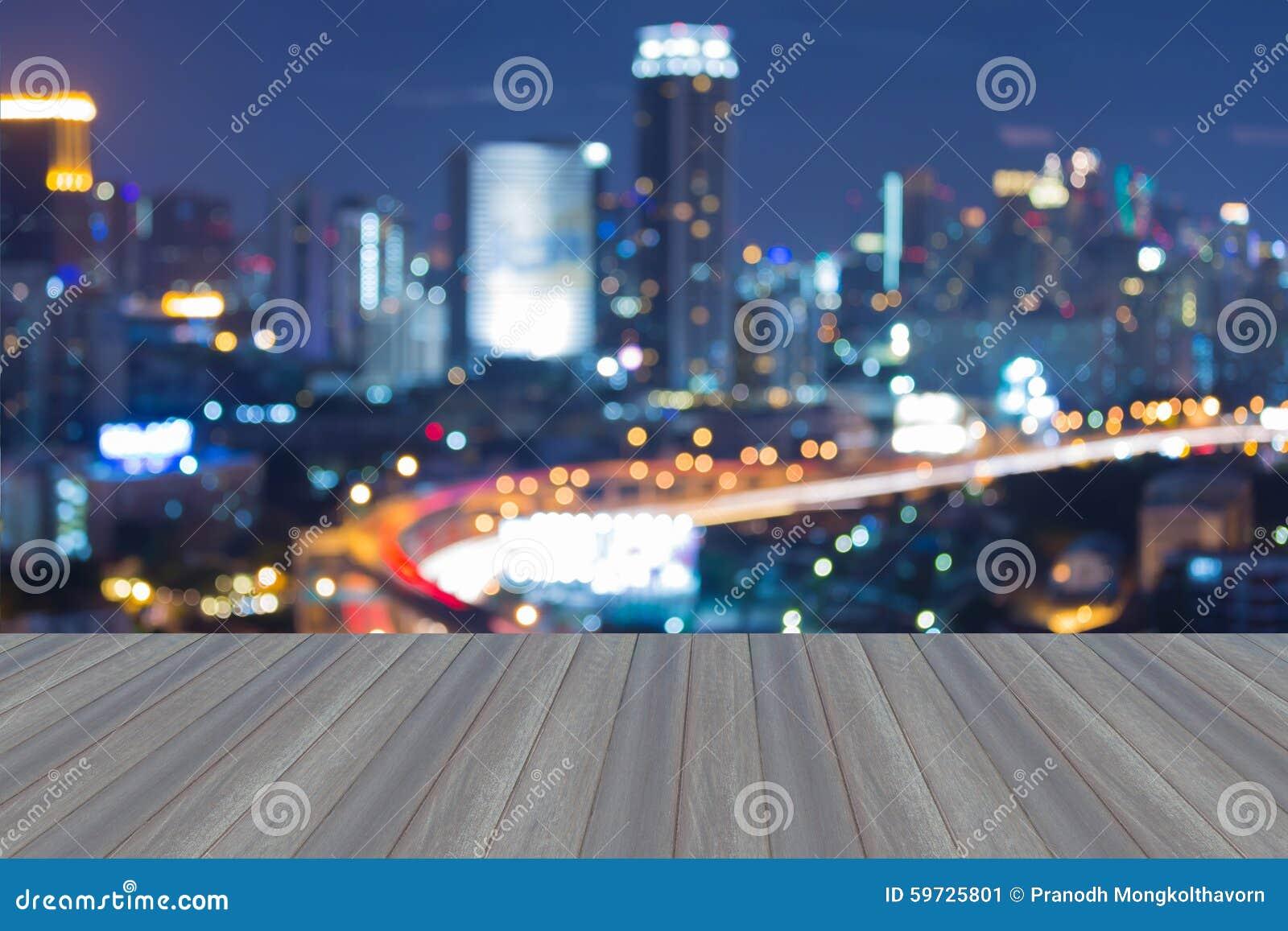 Wooden Floor Roof Top View With Blurred City Bokeh Lights