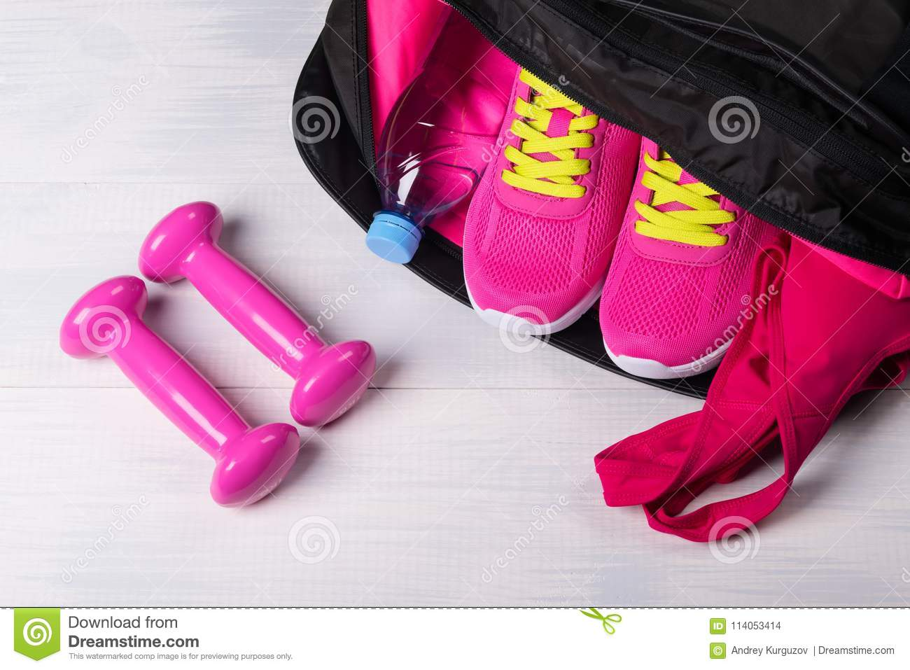9d1c416e4e On The Wooden Floor Sports Bag With Pink Things In It Uncovered