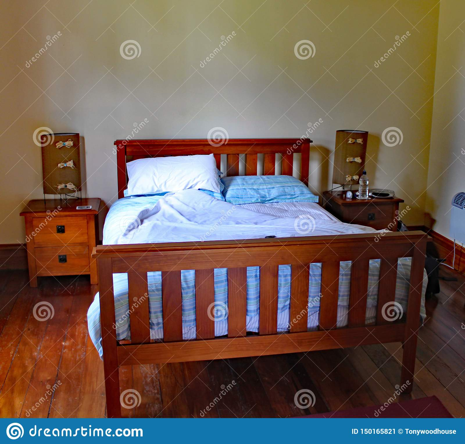 Wooden framed double bed in a quirky rental property in Masterton in New Zealand