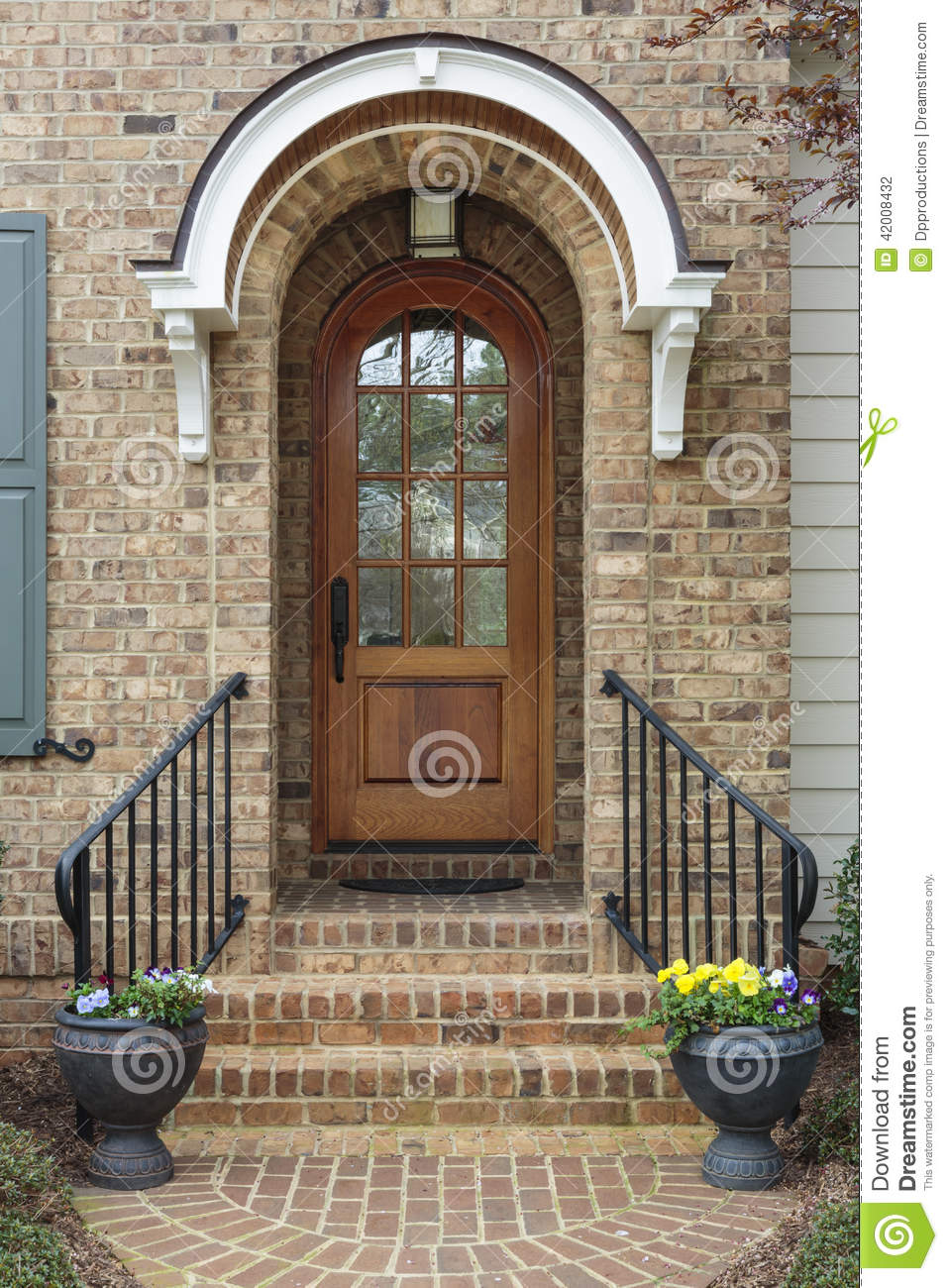 Wooden Front Door Of Family Home With Arch Stock Photo - Image ...