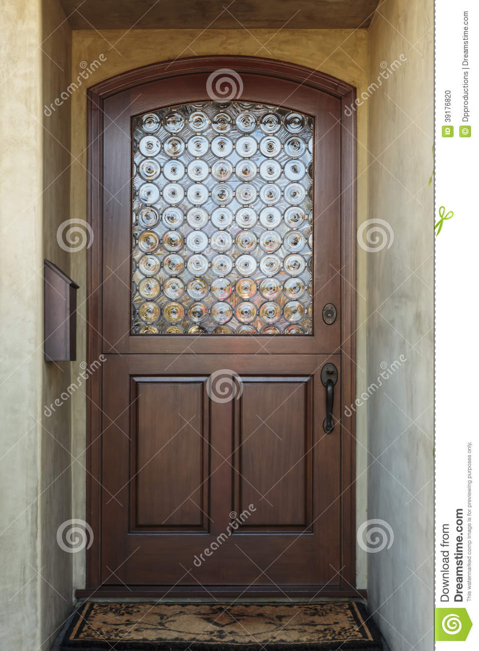 Wooden front door of home with ornate glass detail stock for Puertas madera con cristal