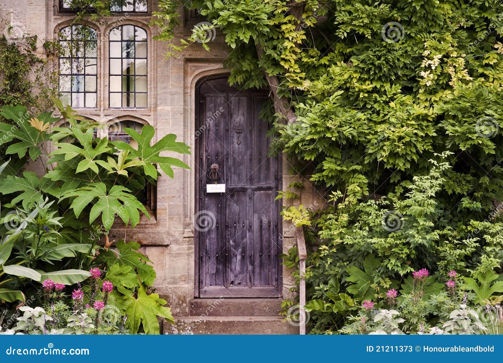 Wooden front door of old stone brick house stock photos for Door of stone