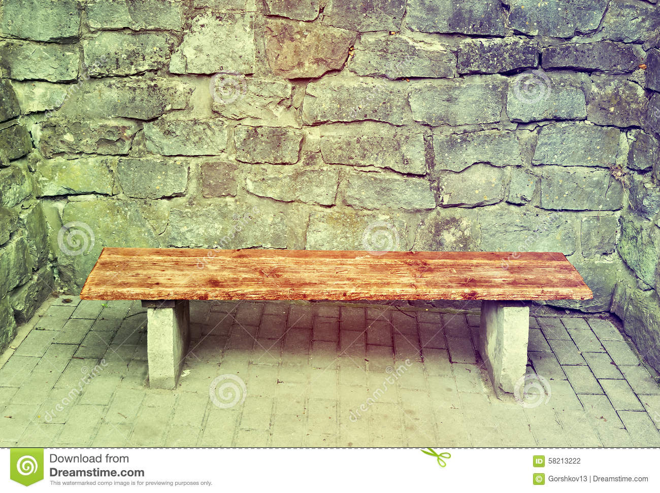 Stupendous Wooden Garden Bench At Medieval Brick Wall Stock Photo Machost Co Dining Chair Design Ideas Machostcouk