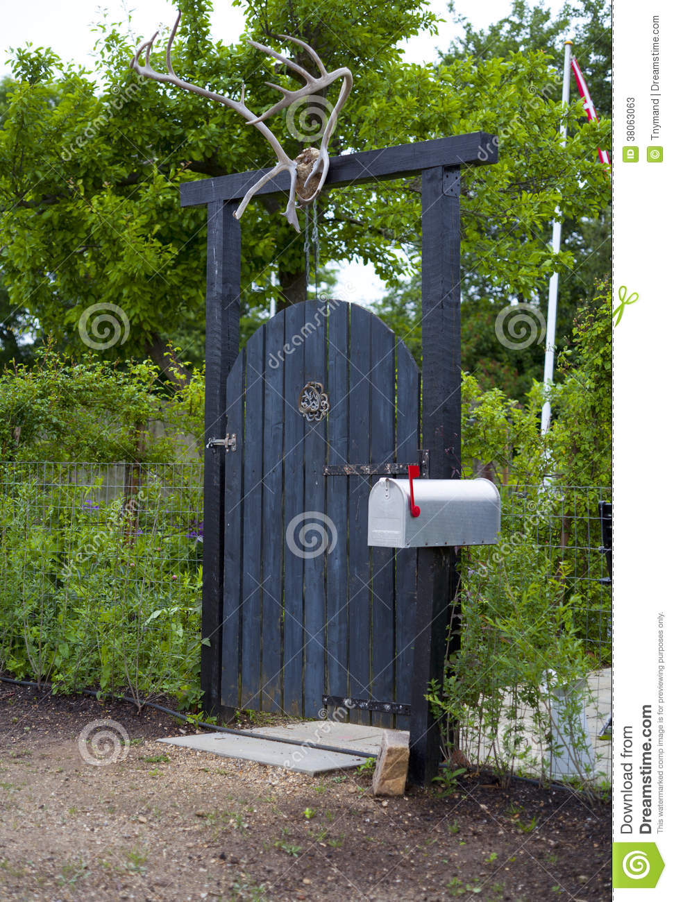 Wooden Garden Gate With Deer Antler And Mailbox Stock