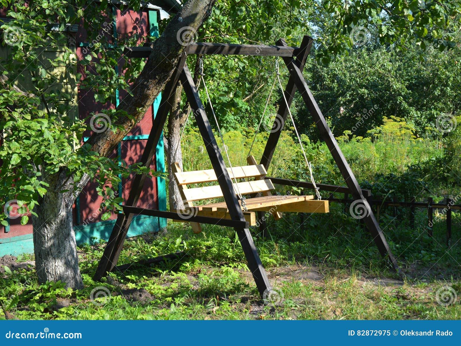 Wooden Garden Swing Garden Swing Seat In Tree Shadow Stock