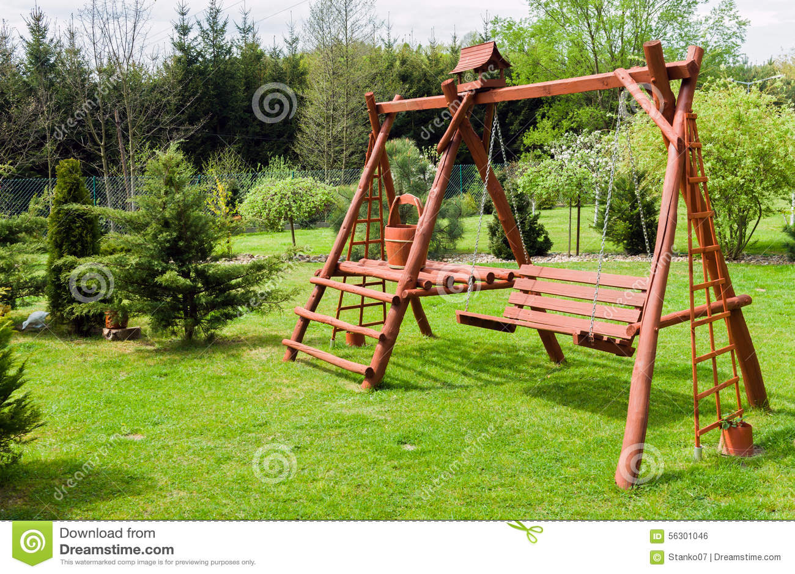 Wooden Garden Swing. Wooden Homemade Garden Architecture Royalty Free Stock  Image