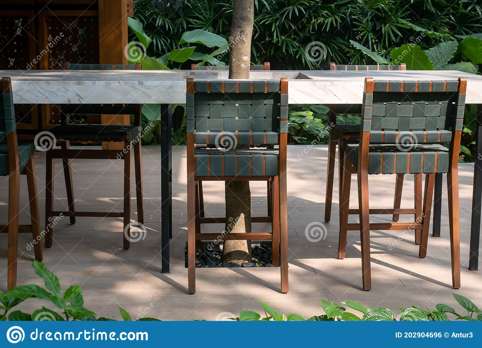 Wooden Green Chairs With White Marble Table On Outside House Background Stock Photo Image Of Chairs Decor 202904696
