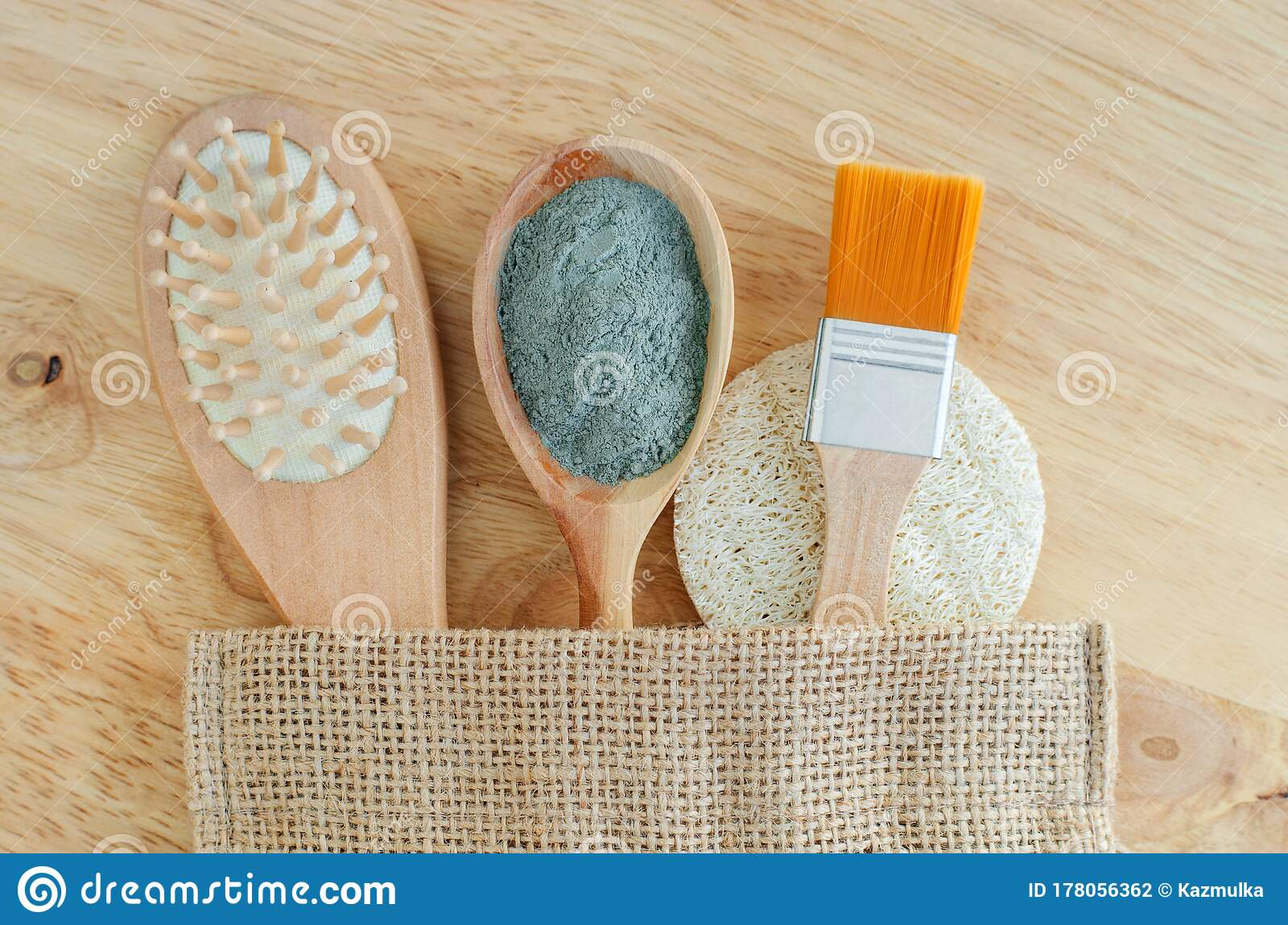 Wooden Hairbrush, Spoon With Blue Bentonite Clay Powder, Make-up Brush And Loofah Sponge. Natural Beauty Treatment Stock Photo