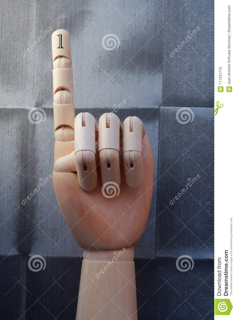 Wooden hand with one finger raised and numbered with number one