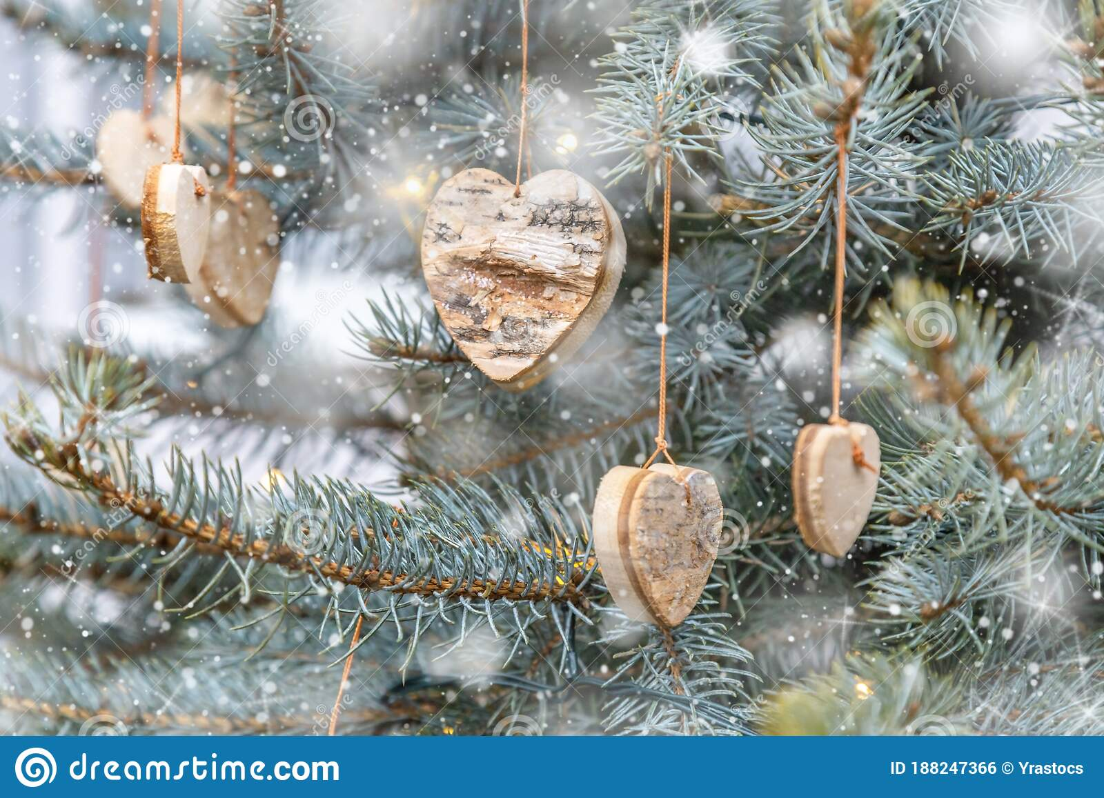 Wooden Handmade Christmas Tree Decorations In Shape Of Heart Hang On Green Christmas Tree Falling Snow Stock Photo Image Of Pine Snow 188247366