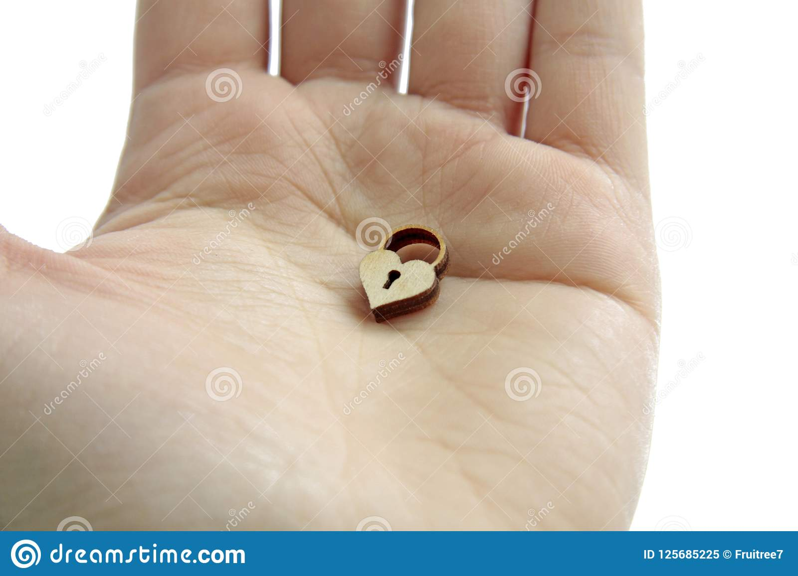 Wooden heart lock in hand on isolated background