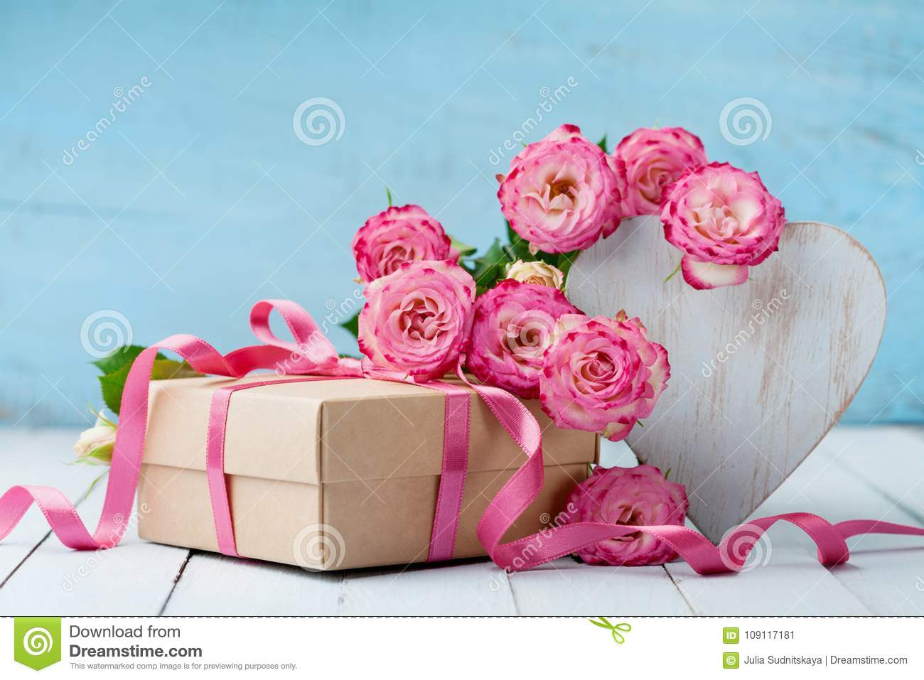 Wooden Heart Pink Rose Flowers And Gift Box On Turquoise Table