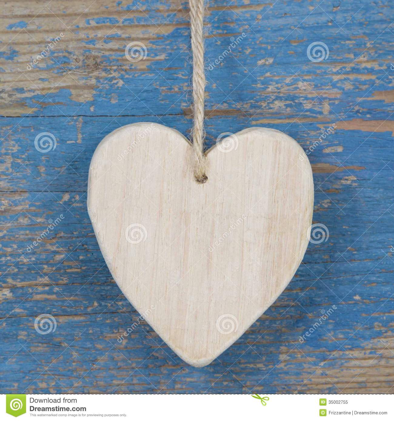 Wooden Heart Shape On Blue Wooden Surface For Valentine