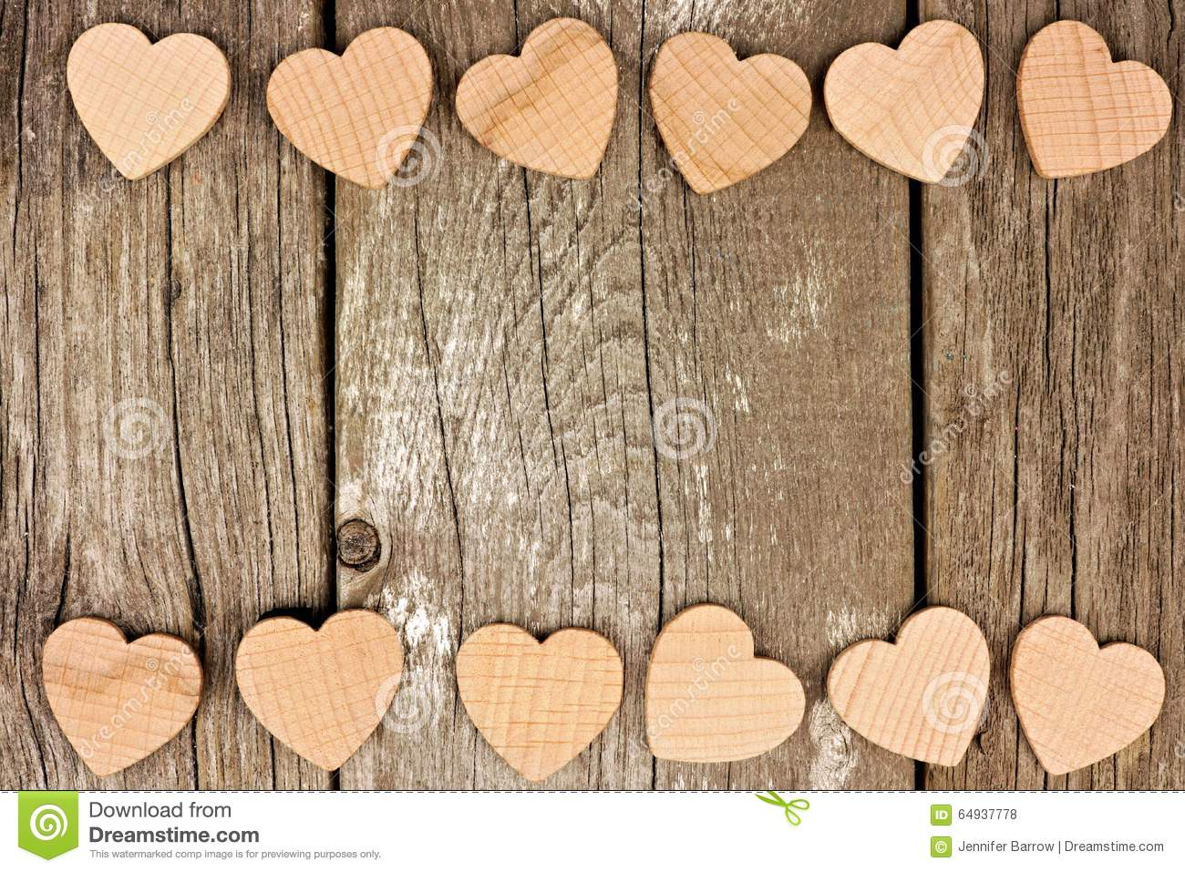 Valentines Day wooden hearts forming a double border on a rustic wood ...