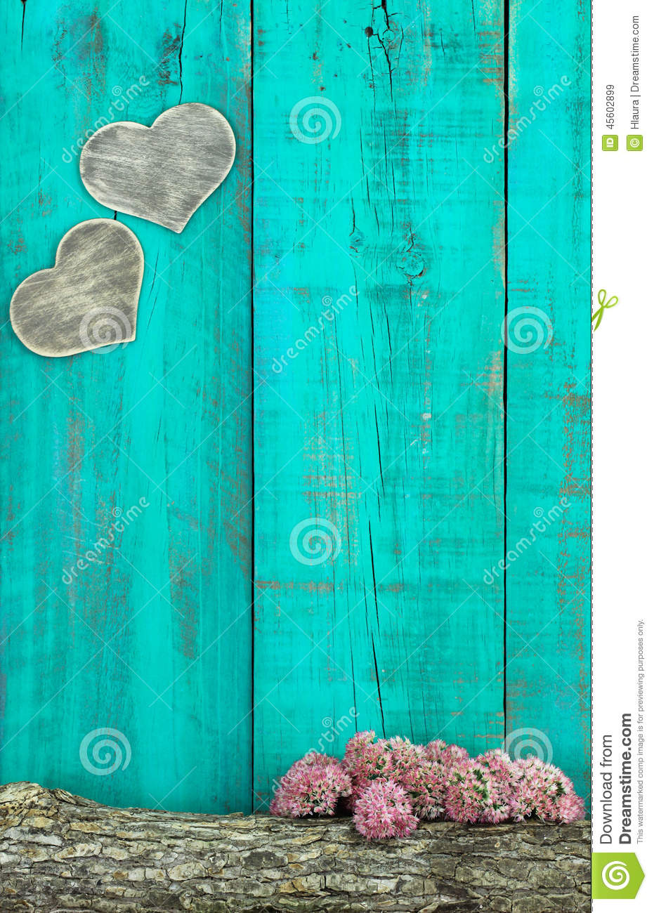 Wooden Hearts Hanging On Antique Teal Blue Fence With Log ...