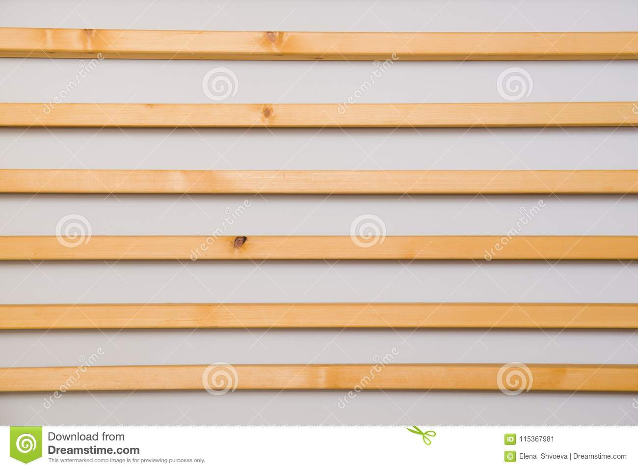 Wooden horizontal slats batten on a light gray wall background. Interior detail, texture, background. The concept of minimalism an