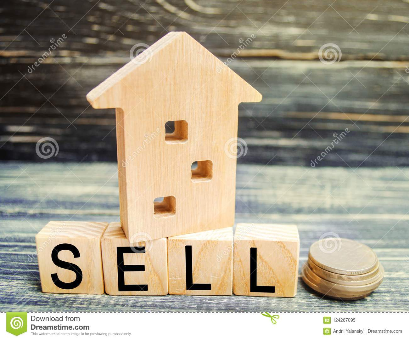 Wooden house on a black background with the inscription sell. sale of property, home, real estate. affordable housing. place for t