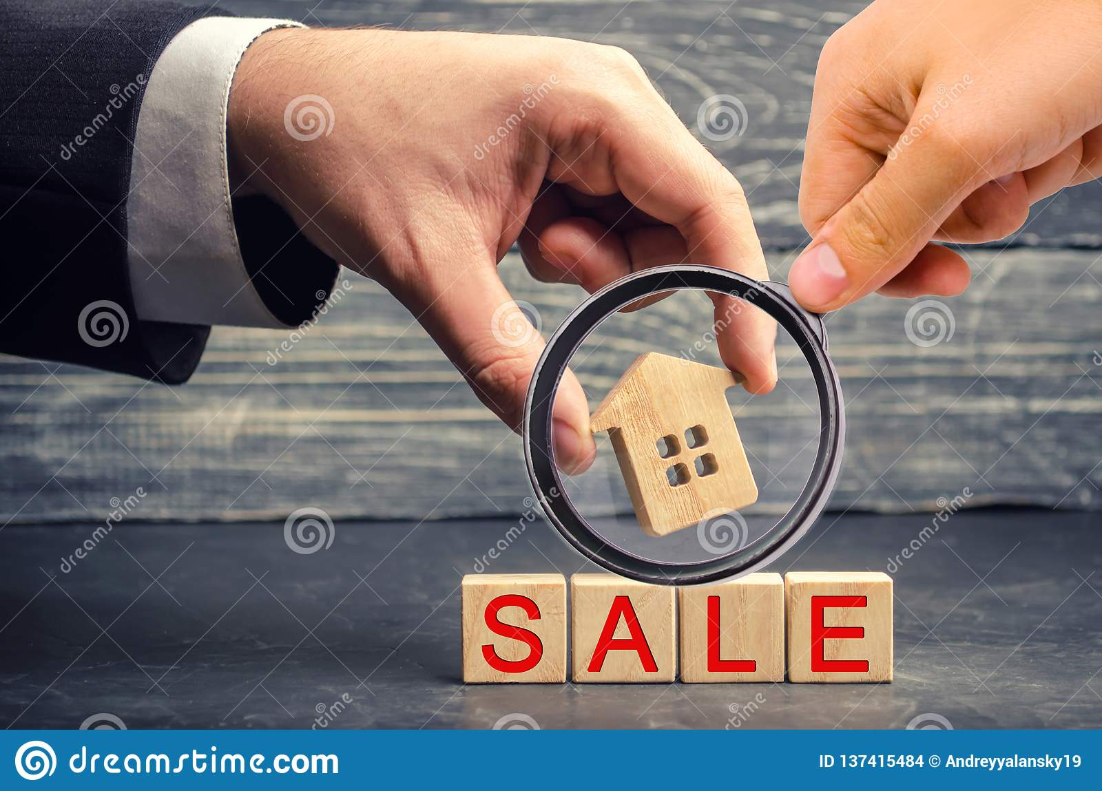 Wooden house with the inscription `sale`. sale of property, home. affordable housing. sale of apartments. real estate agent servic