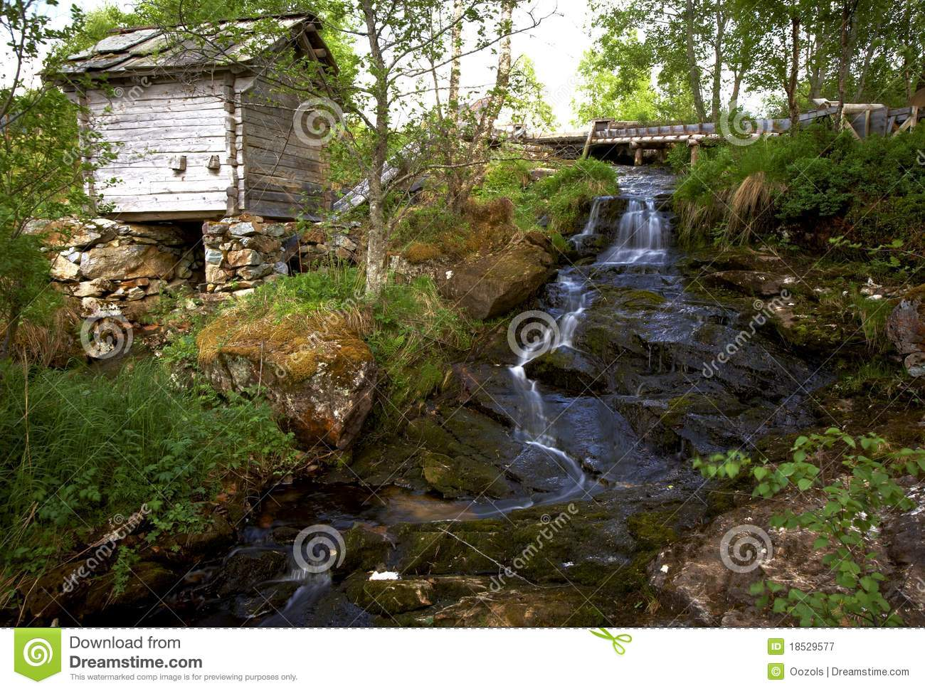 Wooden House Near The Waterfall Royalty Free Stock