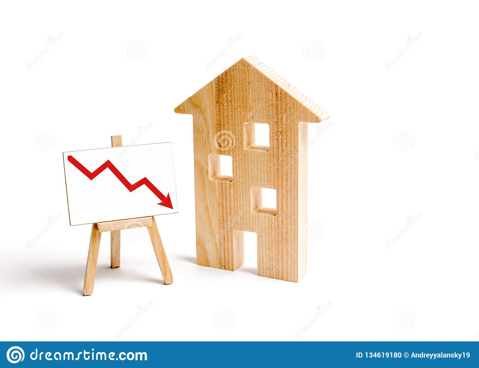 A Wooden house and red arrow down. concept of falling prices and demand for real estate, crisis and recession