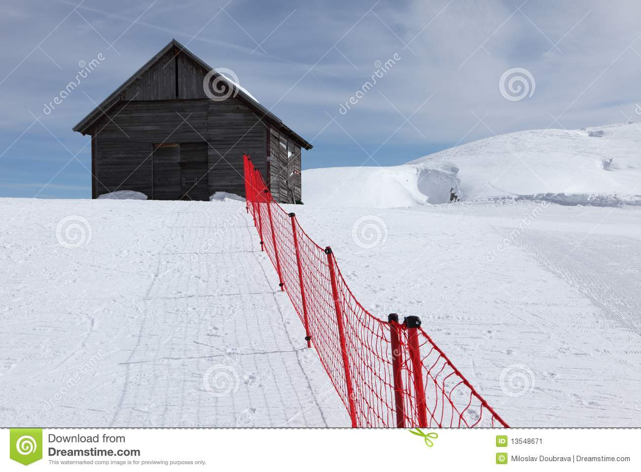 Wooden house and red fence stock image