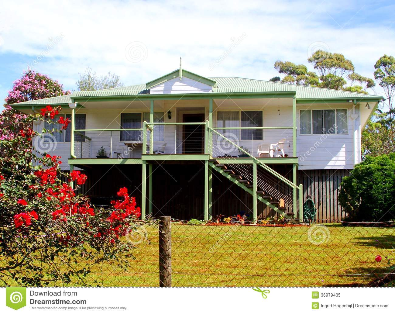 Wooden house with veranda and a garden with blooming flowers in tamborine mountains goldcoast near brisbane in queensland australia