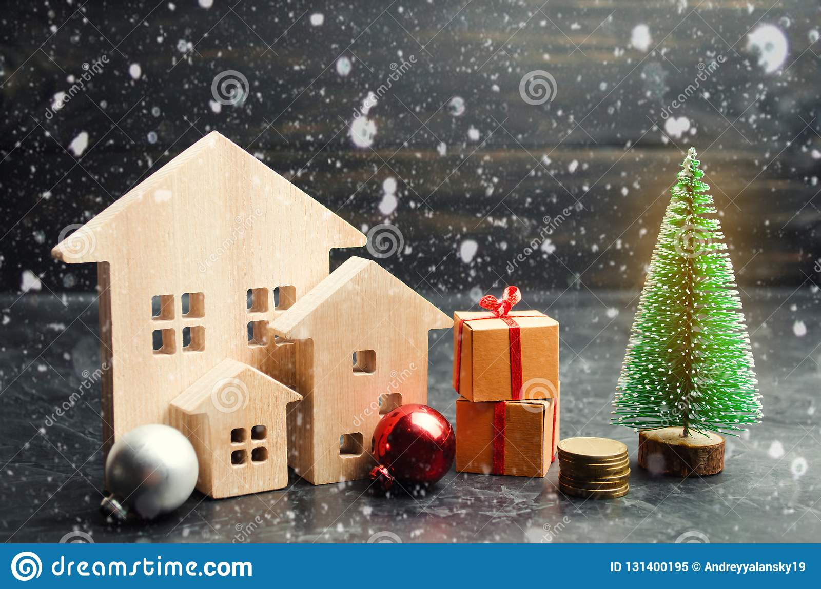 Wooden houses and Christmas tree. Christmas Sale of Real Estate. New Year discounts for buying house. Purchase apartments at a low
