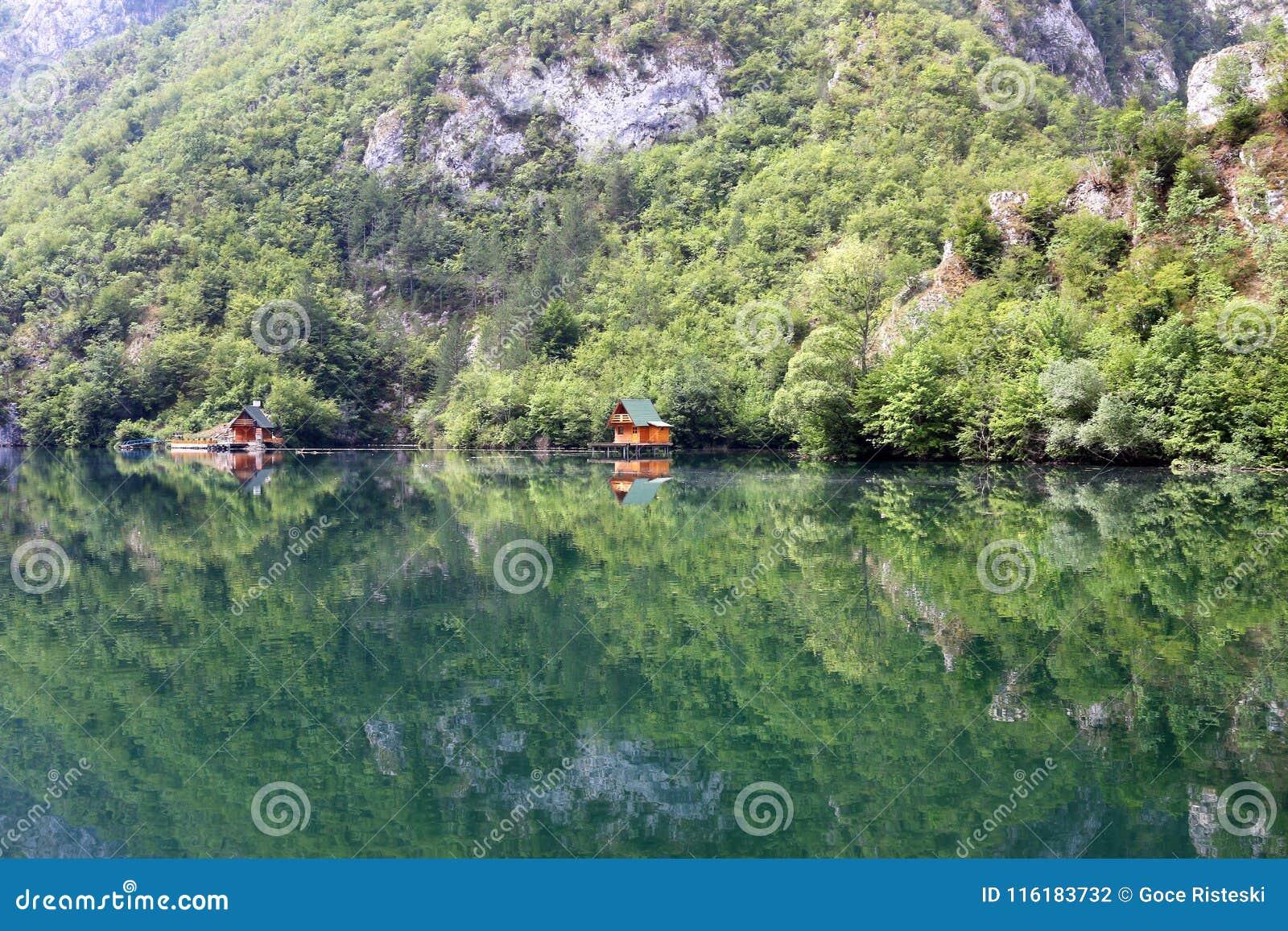 Wooden houses on river Drina landscape summer